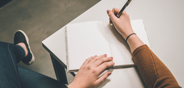 Person making notes on diary