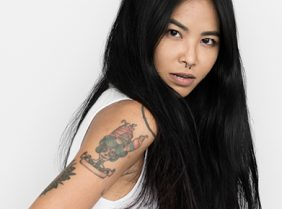 Chinese model with tattoo on her sleeve