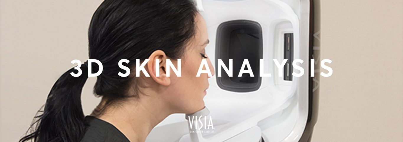 Lady placing her head in a 3D face scanner