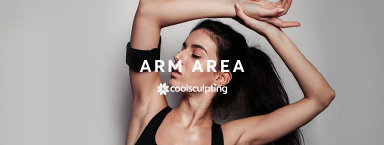 A lady stretching her arms above her head showing her arm fat for CoolSculpting treatment