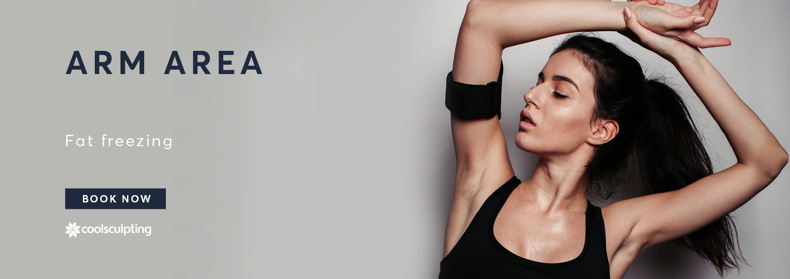 A banner of a lady in her gymwear stretching with her arm area for CoolSculpting